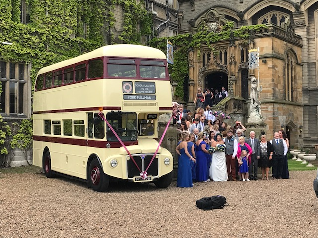 Wedding party in a closed top Routemaster